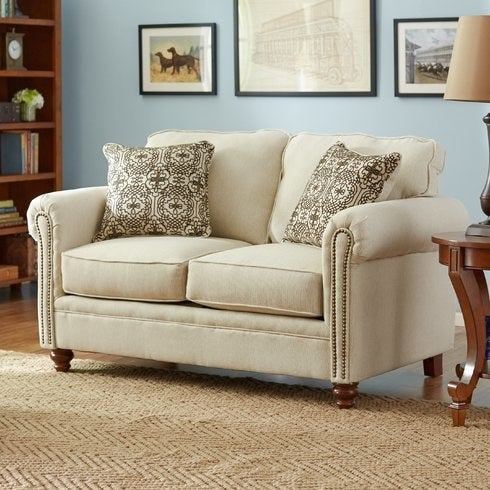 """Promising review: """"Even at the regular price this love seat is worth every penny. It is very comfortable and slightly firm, yet cozy. The color is more cream than white. The throw pillows that came with it work perfectly with my decor. It arrived packaged very well, and the only assembly was to attach the four feet. Excellent experience!"""" — LoriShipping: Free!Get the loveseat from Wayfair for $379.99."""