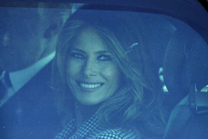 Melania Trump smiles from the presidential state car on May 24, 2017.