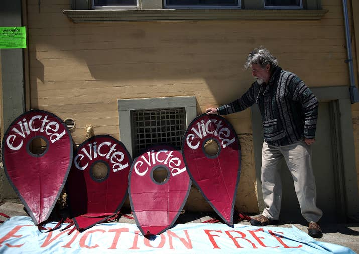 A protester in 2014, demonstrating outside a San Francisco apartment building that allegedly evicted its tenants to make way for AirBnb rentals.
