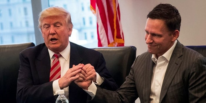 President Donald Trump shakes hands with billionaire venture capitalist and supporter Peter Thiel during a December meeting with technology leaders.
