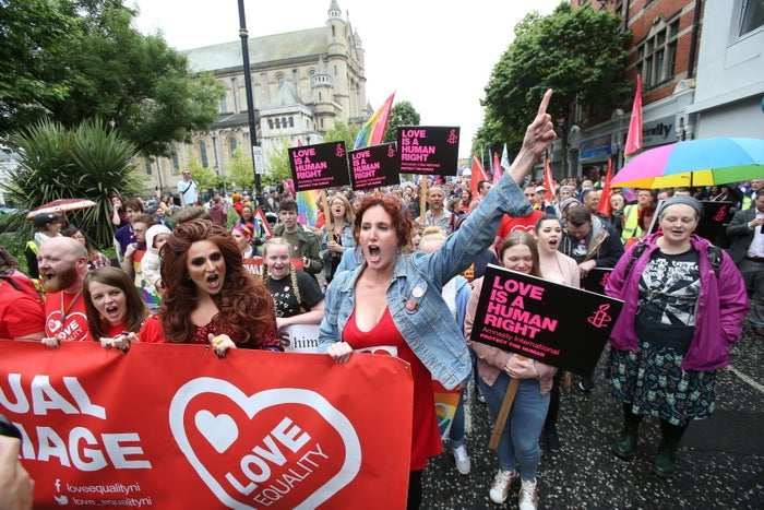 Bronagh Waugh (centre) raises her arm at the march.