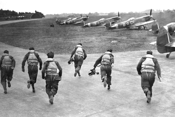 "At Biggin Hill on Sept. 14, 1946, Royal Air Force pilots ""scramble"" at the signal as they did during the hectic days of the Battle of Britain."