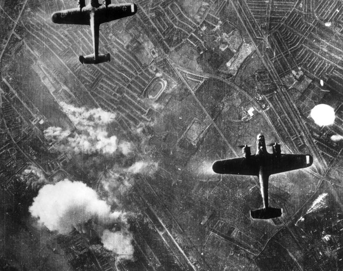Two German Dornier planes fly over the Silvertown area of London's Docklands for a bombing run in 1940.