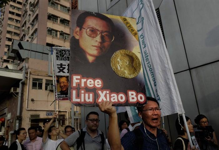 An activist holds a placard demanding the release of Liu Xiaobo.