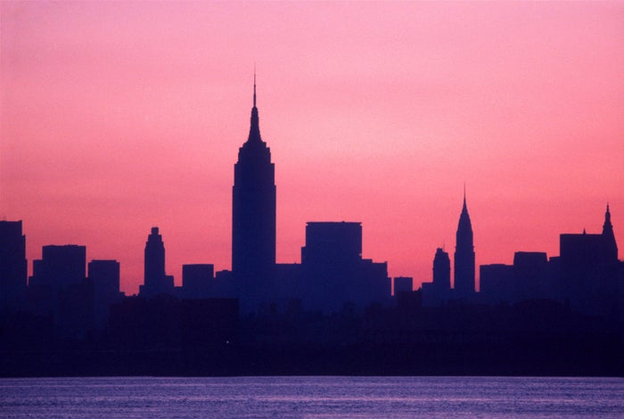 At dawn on July 14, the Manhattan skyline shows no lights due to the blackout.