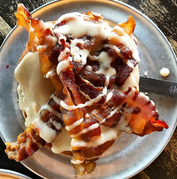 Far more extravagant than your basic bacon maple creation, this epic doughnut features cream cheese icing, thick chunks of bacon, strawberry jalapeño jelly, and candied jalapeños. The result: Every bite is sweet, spicy, fatty, and delicious.
