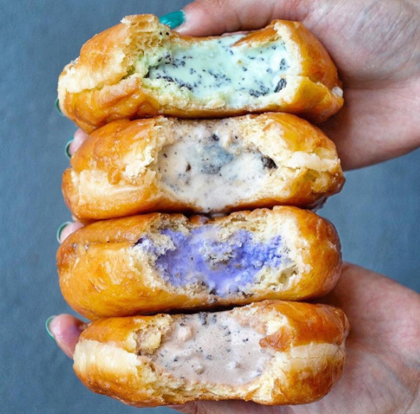 These ice-cream filled doughnuts come in six different flavors, including chocolate malted crunch and ube (purple yam).