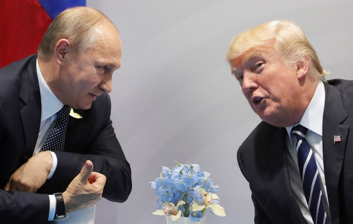 Donald Trump and Vladimir Putin meet on the sidelines of the G20 Summit in Hamburg, Germany, on July 7, 2017. A few days later, the president's son Donald Jr. released emails suggesting that the Russian government was eager to help Trump's campaign.