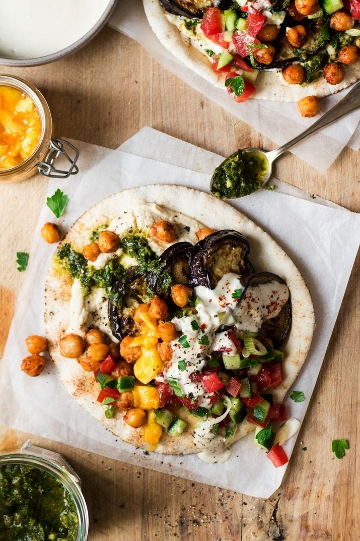 This middle eastern fried eggplant pita is loaded with Israeli salad, hummus, tahini, and spicy chickpeas. If you don't have the time to make the hummus and tahini from scratch, store-bought spreads will taste just as good. Get the recipe.