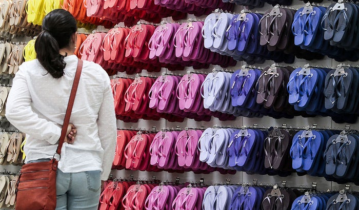Roughly 200 million pairs of the brightly colored sandals are sold every year around the world.