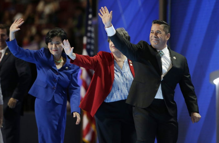 DCCC chair Rep. Ben Ray Lujan leads congressional candidates offstage at the DNC last summer.