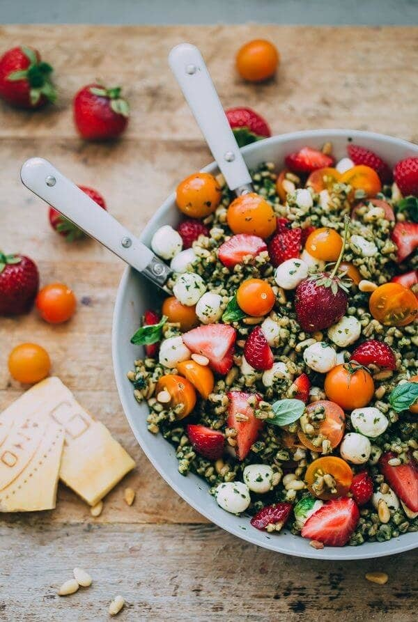Farro takes the place of greens in this summer salad, tossed with pesto, strawberries, tomatoes, and mozzarella. Get the recipe.