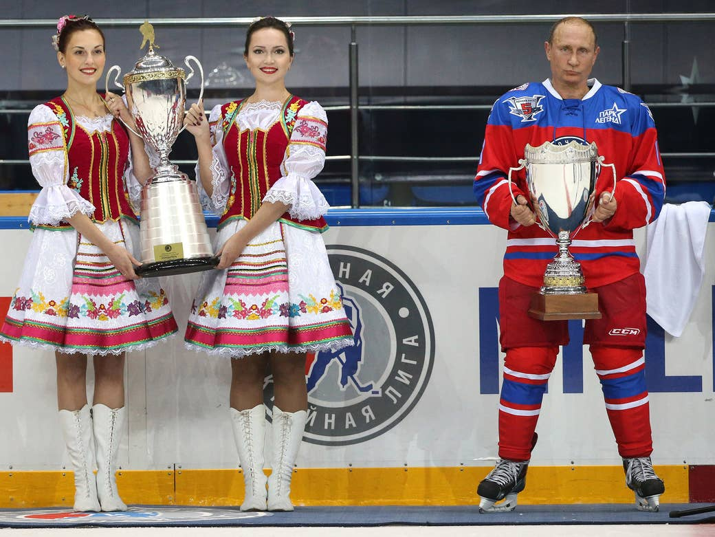Putin attends a Night League ice hockey match on Oct. 7, 2015, in Sochi. He spent his 63rd birthday playing hockey with Night League stars.