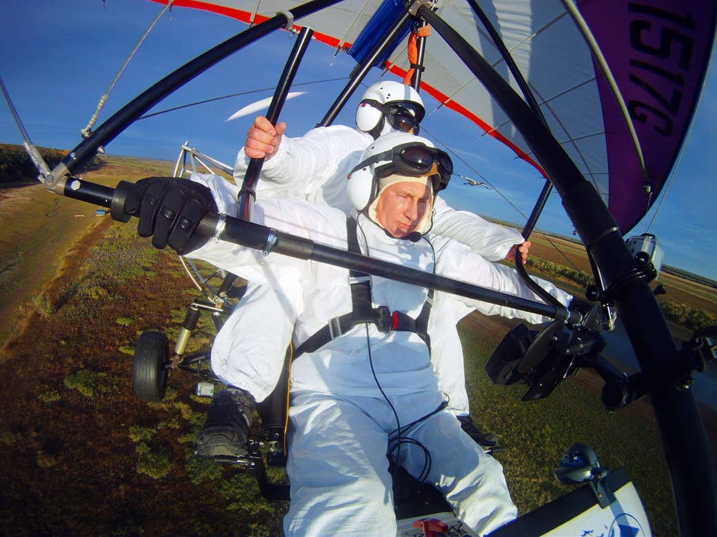 Putin pilots a motorized hang glider as he takes part in a scientific experiment aimed at preserving a rare species of cranes on Sept. 5, 2012.