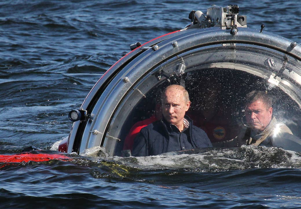 Putin rides in a submersible in the Baltic Sea near Gotland island on July 15, 2013. The vessel dived to the sea floor to explore a sunken ship in the Gulf of Finland.