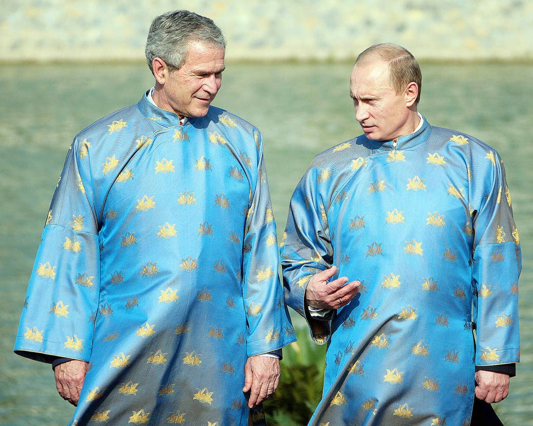Putin and then-US president George W. Bush wear Vietnamese áo dài silk tunics as they take part in an Asia-Pacific Economic Cooperation summit in Hanoi, Vietnam, on Nov. 19, 2006.