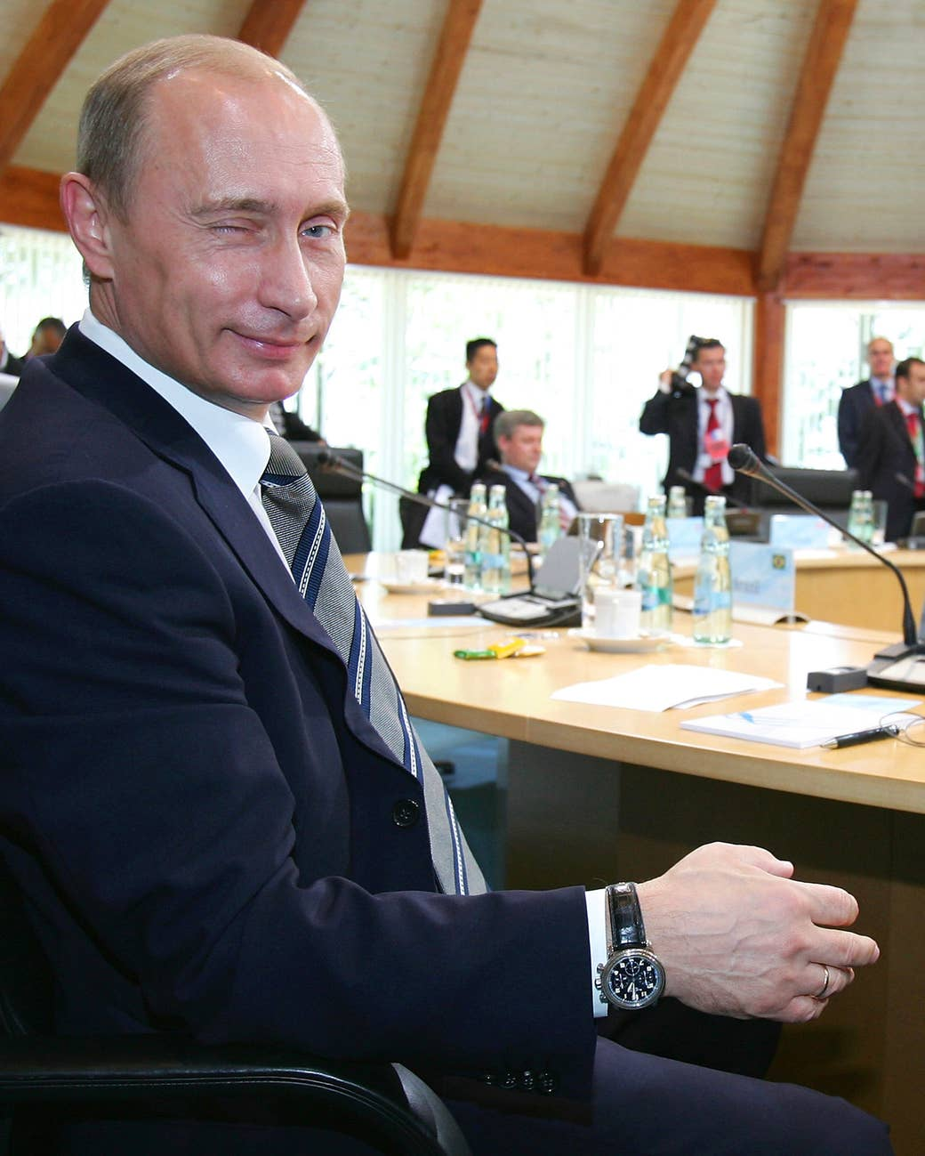 Putin winks to the camera prior to a working session with leaders of the G8 countries and five developing nations on June 8, 2007, in Heiligendamm, Germany.