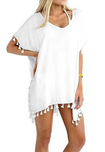 41f0fe8729 A sheer chiffon tunic with tassels for covering up until your bathing suit's  dramatic reveal.