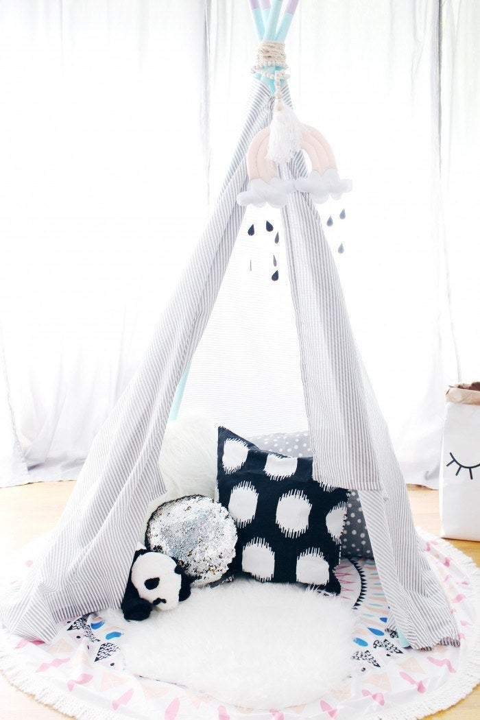 Get a similar teepee from Amazon for $84.99. Get the full instructions from A Joyful Riot here.