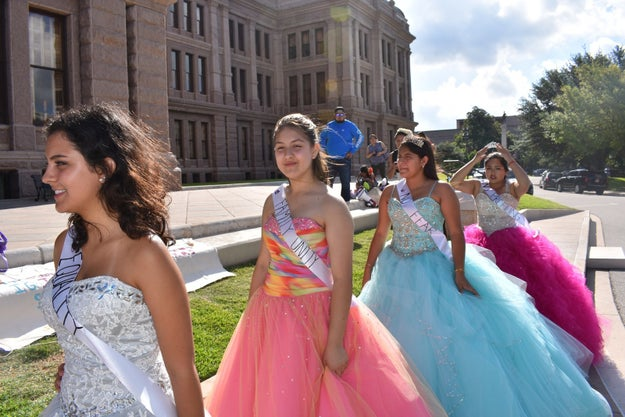 """""""It discriminates against people for being brown,"""" Magdalena Juarez, a 17-year-old who appeared in her red quinceañera gown at the protest, told BuzzFeed News. Her parents are from Mexico."""