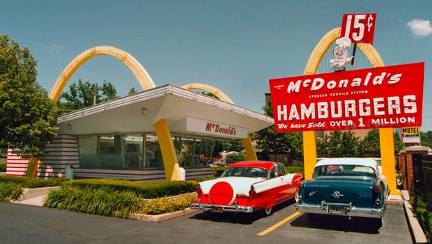 Come again? You want to travel to the first McDonald's restaurant in 1955? Huh. That's specific. But we're not here to judge. You might as well grab some food while you're there!
