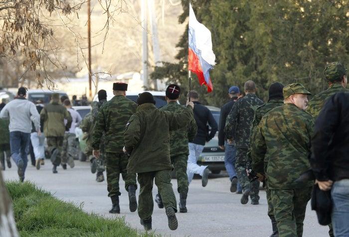 Russian troops, or Little Green Men, in a town near Crimea in 2014.