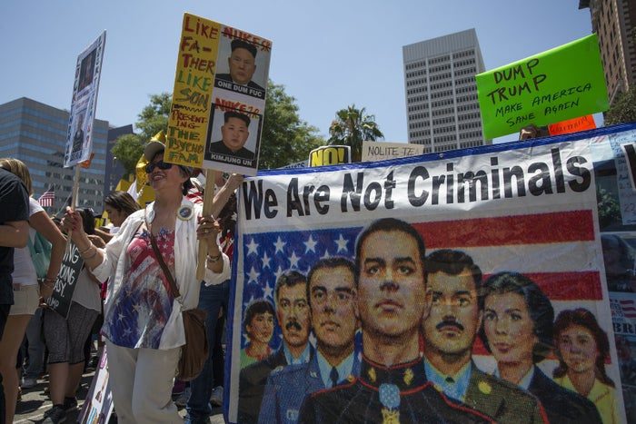 Marchers protest the deportation of undocumented military veterans in Los Angeles in July 2017.