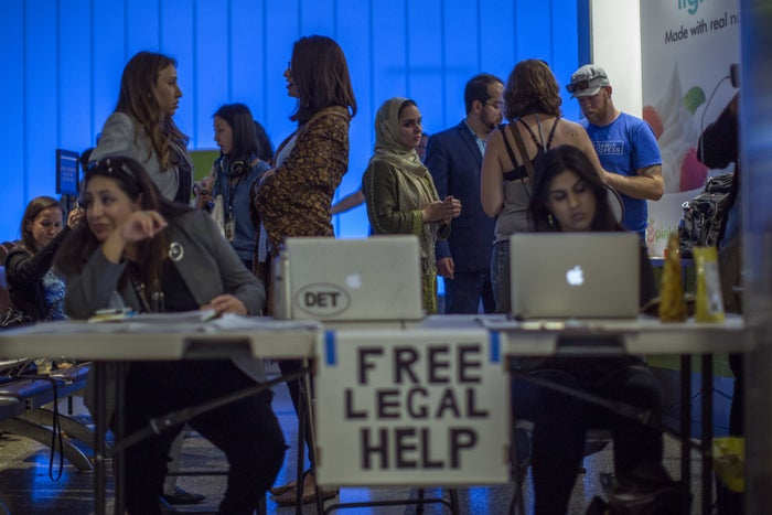 Attorneys provide free legal help to incoming international travelers in Los Angeles in June 2017 in the wake of the partial reinstatement of travel restrictions.