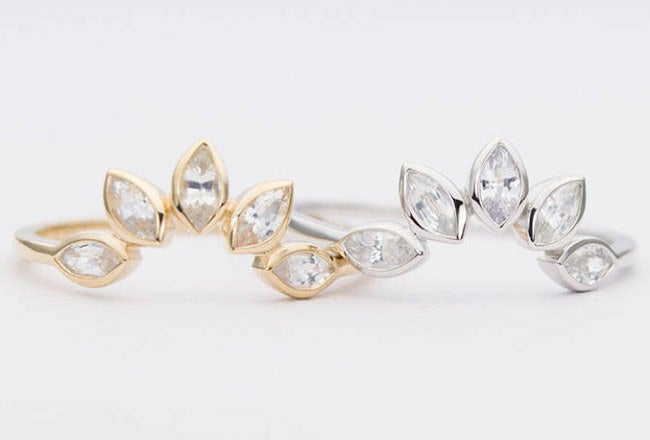 """Promising Review: """"I truly love my wedding band. It's delicate without being fragile. And the moon stones are beautiful and not too flashy."""" —MJ Massy Get it from Aurora Designer on Etsy for $198+ (available in three finishes, sizes 3–9)."""