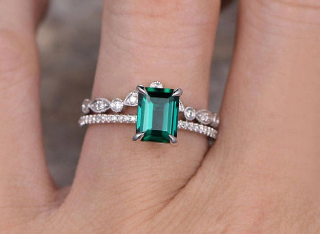 A emerald ring set that features two bands that'll have folks wondering if you had a destination wedding in the Land of Oz.