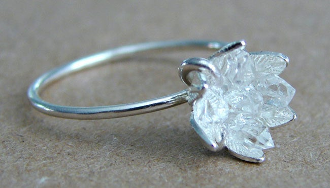 "Promising Review: ""This ring is so beautiful and extremely well crafted. I'm absolutely in love with it! It doesn't feature any tacky or unsustainably sourced diamonds, which I love! The crystal stalagmites are beautiful and the perfect size and shape. The flower setting is very clean and unique! I couldn't be happier with my wedding ring."" —Jacline Murillo Get it from Gemologies on Etsy for $265 (available in sizes 4-9)"