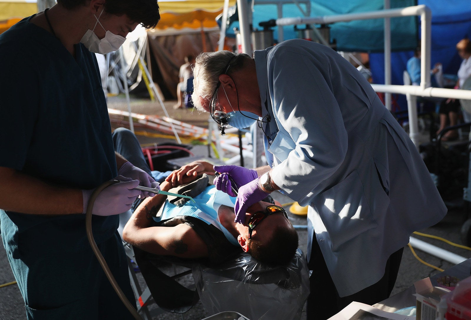 A patient receives medical care from onsite dentists in Wise on July 21.