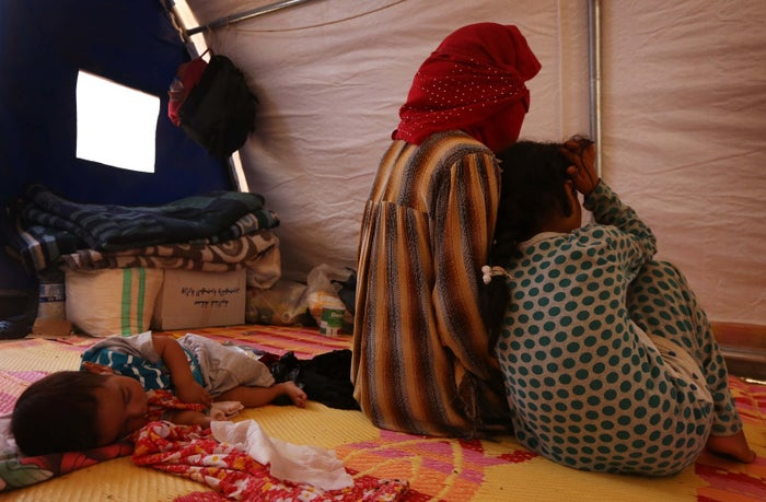 A displaced Iraqi woman, whose family members are accused of being ISIS militants, sat in a tent at the Al-Jadaa camp south of Mosul on July 19. More than 80 families, mostly women and children who had a husband or father among the ranks of ISIS, are housed at the camp.