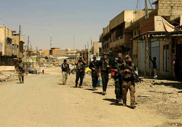 Members of Iraq's Counter Terrorism Service patrol on foot in western Mosul, Iraq, July 20, 2017. Iraqi forces have been accused of extrajudicial killings by human rights groups.