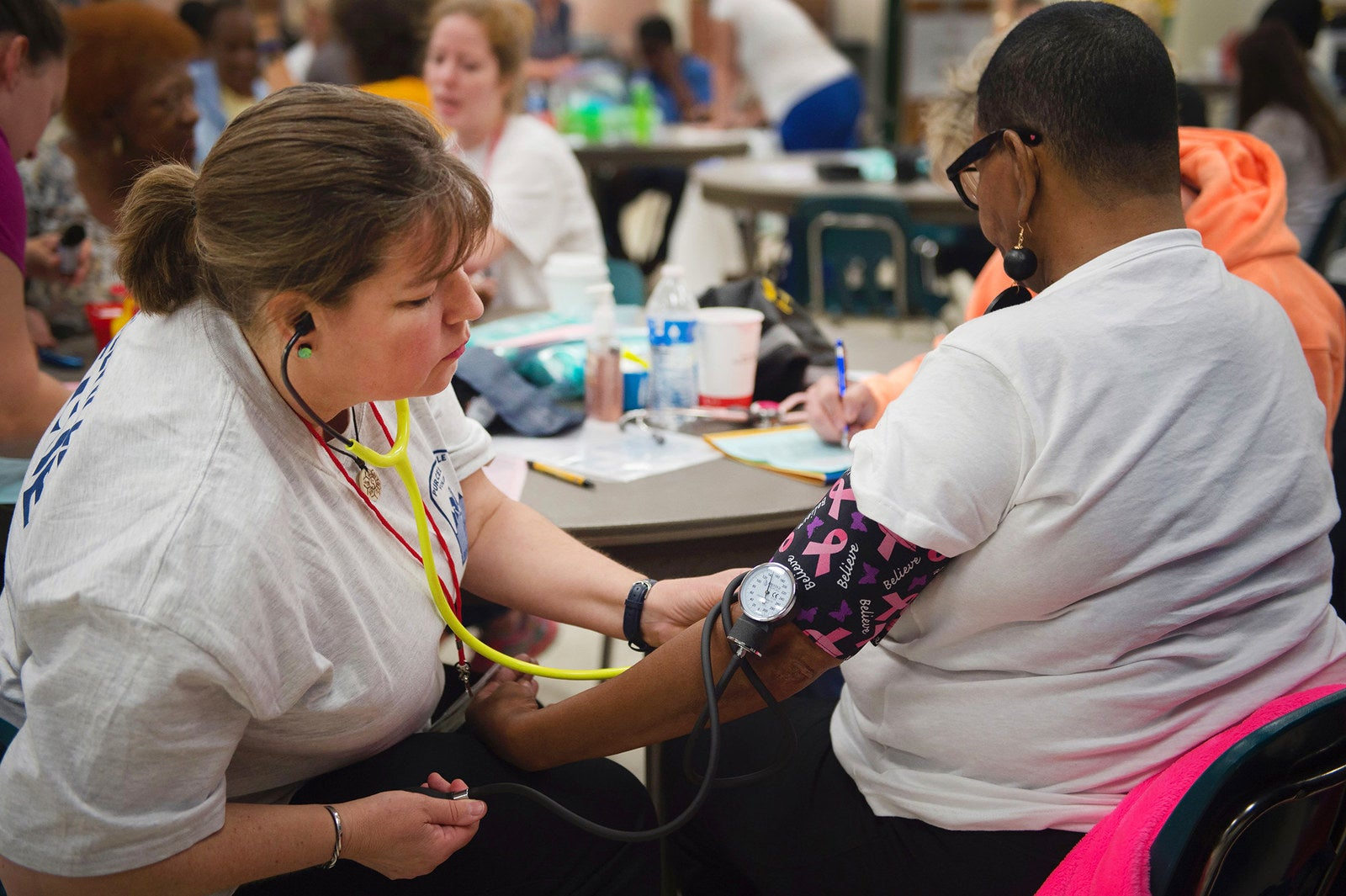 A nurse checks the blood pressure of a patient at Greensville County High School on June 25.