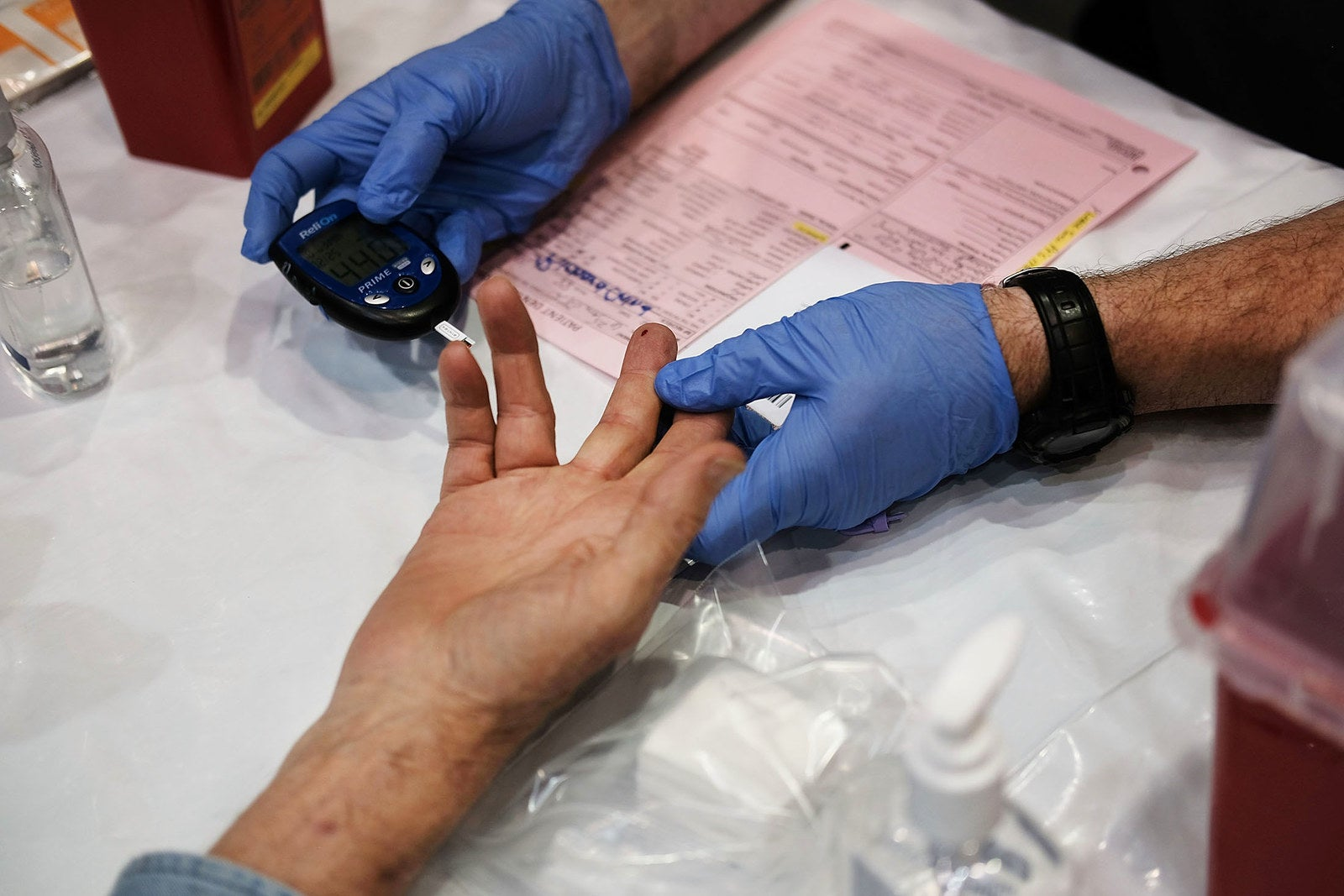 A man has his blood tested at the RAM clinic in Olean, New York, on June 10.
