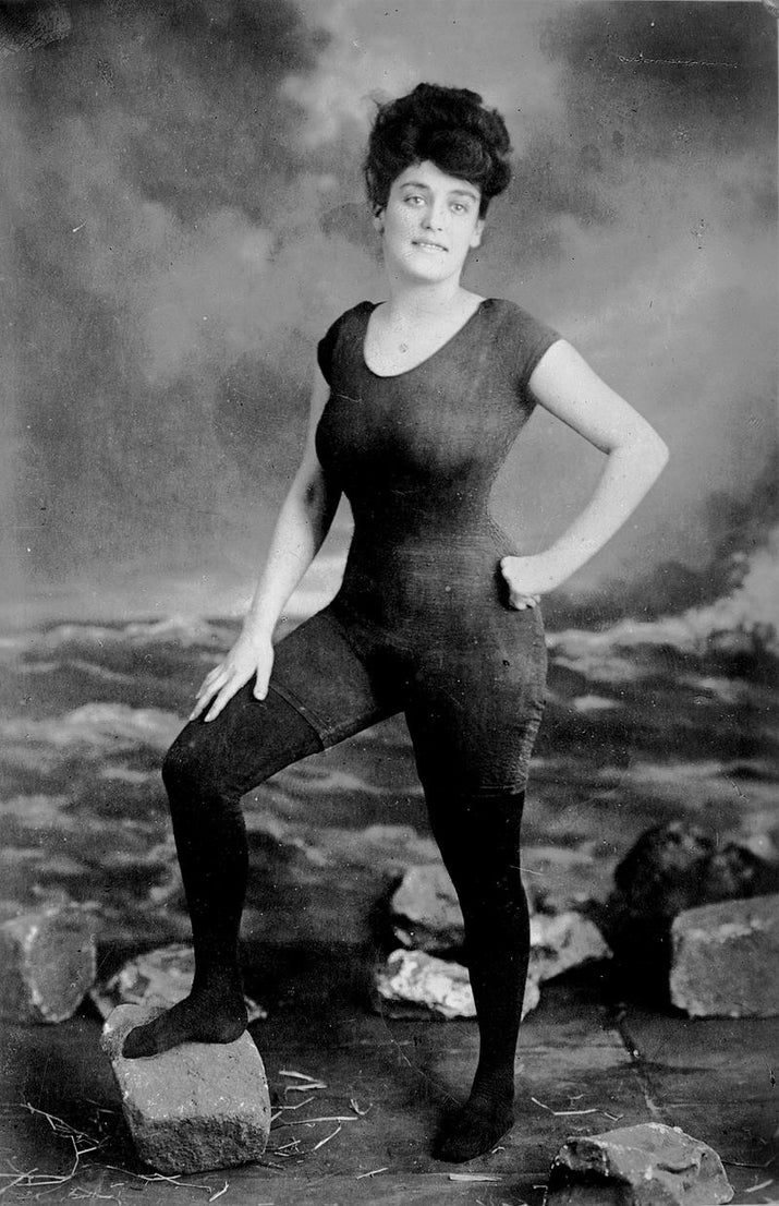 "How scandalous! At the time, swimmers, especially women, did not show off anything above the knee. Kellerman, aka ""The Original Mermaid,"" designed the suit herself and is considered the first woman to publicly wear a one-piece swimsuit, even if it didn't end too well for her."