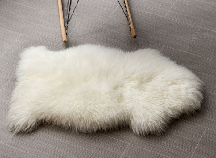 """Promising review: """"Great product; beautiful white. Size was pretty much what I expected. No smell, as some people complained! This is not for decorative purposes. I have neuropathy, and my feet are always cold and in pain. It's so cozy and warm to put my feet on while sitting in the living room. When it's bedtime, I move it to the bed where my feet can rest on it, since the mattress is still too hard against my feet. It provides just enough cushion to relieve some of the pain and pressure. I don't know why I didn't think of this sooner! """" —MargitGet it from Amazon for $50 (available in 12 colors)."""
