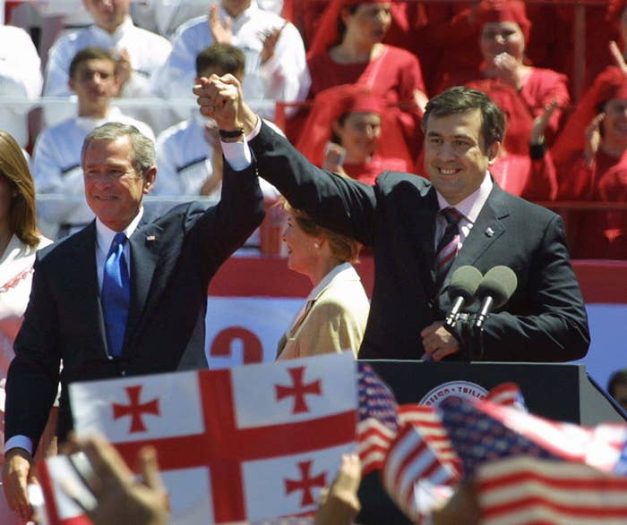 US President George W. Bush and then-Georgian President Mikheil Saakashvili (in Tibilisi, the Georgian capital, in May 2005. A grenade was thrown near the stage while Bush was giving a speech. Saakashvili, who a decade later gave up his Georgian citizenship, was stripped of his Ukrainian citizenship Wednesday.