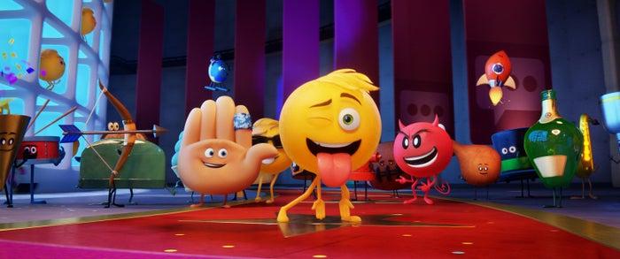Hi-5 (James Corden), Gene (T.J. Miller), and Devil (Sean Hayes) with other emojis in The Emoji Movie.