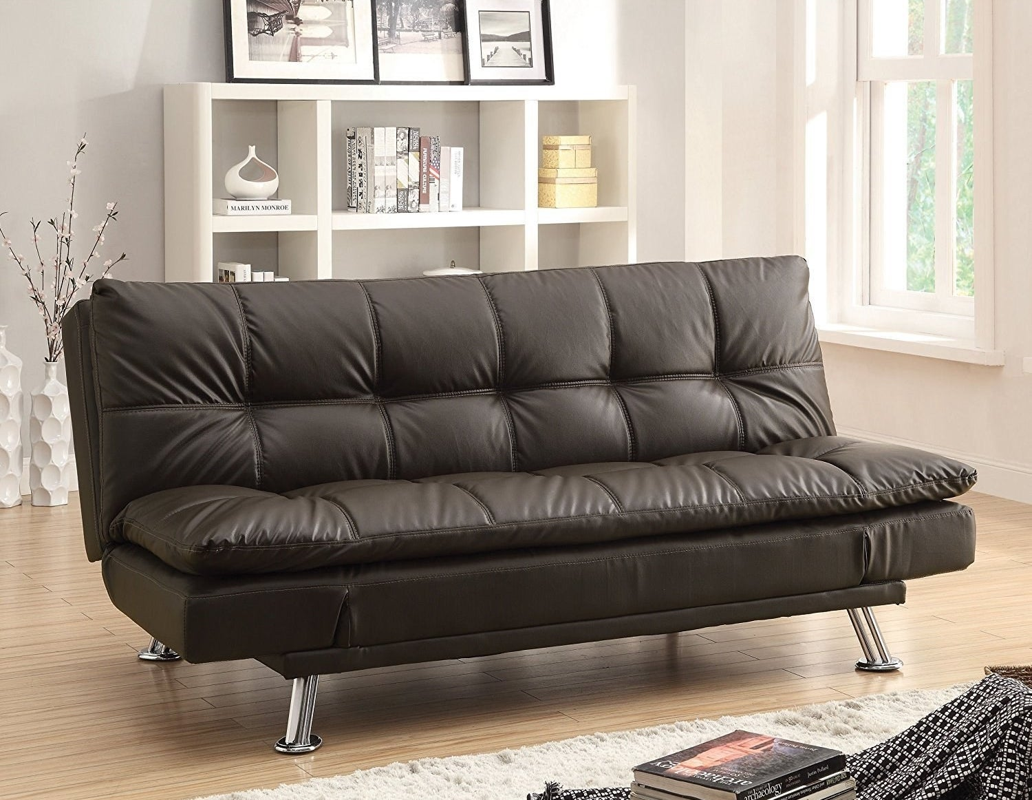 "Promising Review: ""Well made faux-leather futon couch. I've received lots of compliments on it. Only wish it could fit more than two people when the sides are up."" —boriqatPrice: $319.68"