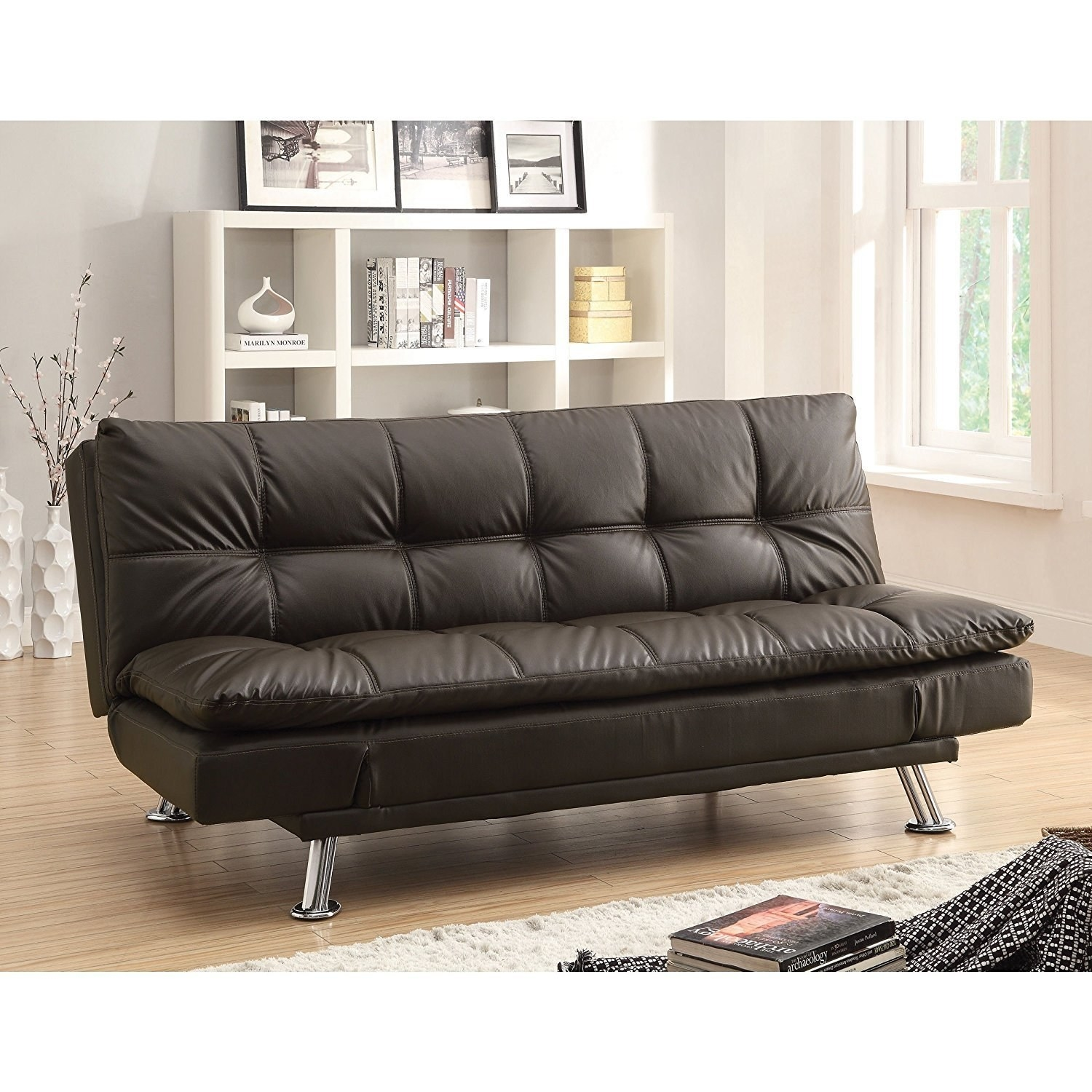 a sofa bed for those living in a small apartment bedroom that want a bed they can easily foldup or host overnight guests on