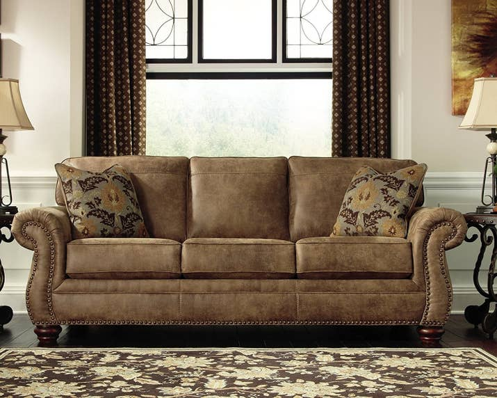 "Promising Review: ""Wow, what a deal on a beautiful sofa. We bought this for our cabin. Delivered and installed in our home — they even took all the protective coverings. You can fall asleep on this sofa and dream. You'll think it's made of the finest materials, as it's soft and plush. So happy we bought it."" —DemetriosPrice: $524.99"