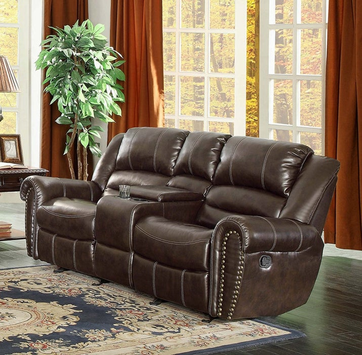 "Promising Review: ""Gorgeous recliner; so happy I ordered it. The nailhead feature is beautiful. This is very spacious to sit in, and extremely comfortable. We fight over who gets to sit in it. The glider is soothing, and the recliner does recline back very far. Love it!"" —AlexandraPrice: $749 (available in two colors, and six styles)"