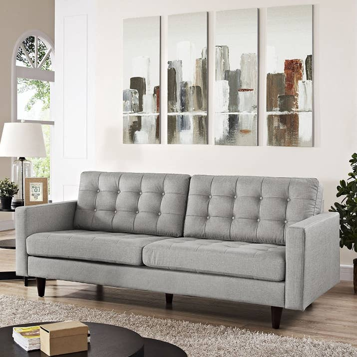 """Promising Review: """"Very comfortable couch! I was nervous buying something so big/expensive online, but after searching all over the web, and visiting multiple stores in person, I'm still glad I decided to give this couch a try. The back cushions can easily be removed, and the seat cushions extend all the way to the back, which allows ample space to sleep on and use as a spare bed. It's pretty firm to sit on otherwise, and overall nicely built/designed."""" —idwinterPrice: $659.99 (available in 12 colors)"""