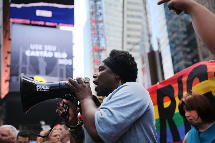 Transgender veteran Tanya Walker speaks to protesters near a military recruitment center in Times Square on July 26. The protesters were venting their anger at President Donald Trump's decision to reinstate a ban on transgender individuals serving in the military.