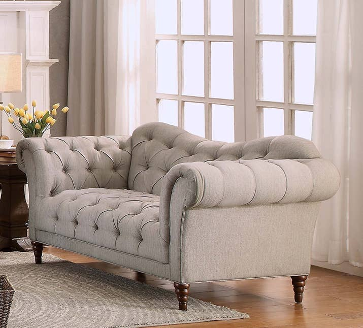 "Promising Review: ""This sofa is so pretty! The sofa is a neutral color, but it has so much personality due to the curve of the back. The herringbone pattern is even more beautiful in person. I love that the tufting is so deep."" —MegmydayPrice: $699+"