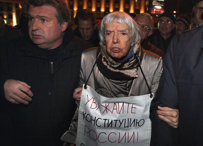 "Lyudmila Alexeyeva holds a poster reading ""Respect the Constitution!"" in Moscow in 2009."