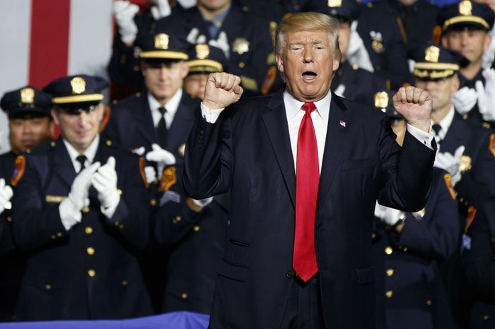 President Donald Trump pumps his fist after speaking to law enforcement officials Friday.