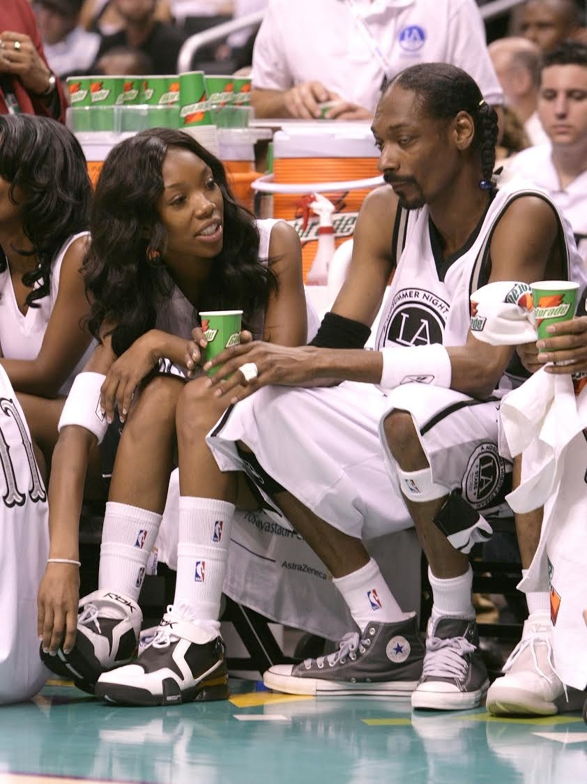 brandy next to snoop at a basketball game